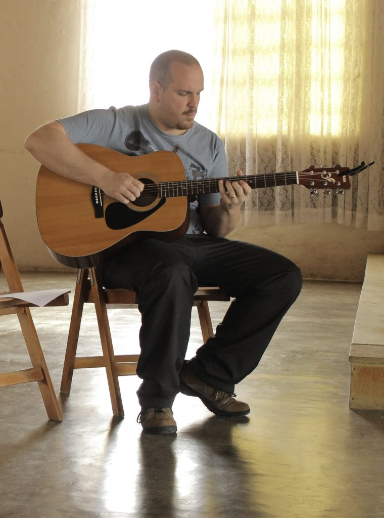 man playing on Yamaha C40